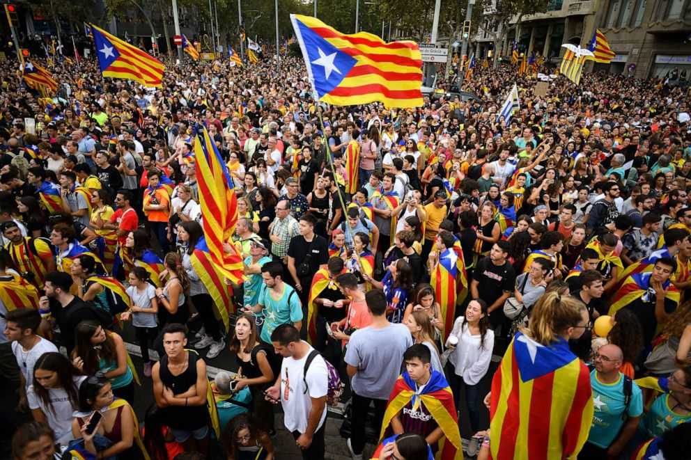 PHOTO: Protesters wave flags in the street as a general strike is called following a week of protests over the jail sentences given to separatist politicians by Spains Supreme Court, on October 18, 2019 in Barcelona, Spain.