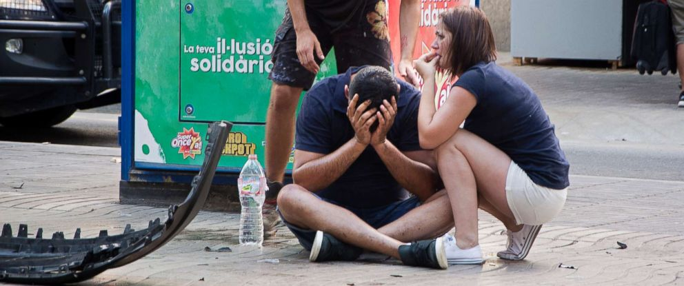 PHOTO: Injured people react after a van crashed into pedestrians on Las Ramblas, in downtown Barcelona, Spain, Aug. 17, 2017.