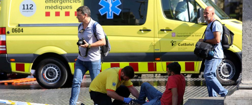 PHOTO: An injured person is treated in Barcelona, Aug. 17, 2017, after a white van jumped the sidewalk in the historic Las Ramblas district.