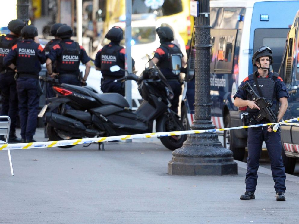 PHOTO: Armed policemen stand in a cordoned off area after a van ploughed into a crowd, injuring several people on the Rambla in Barcelona, Aug. 17, 2017.