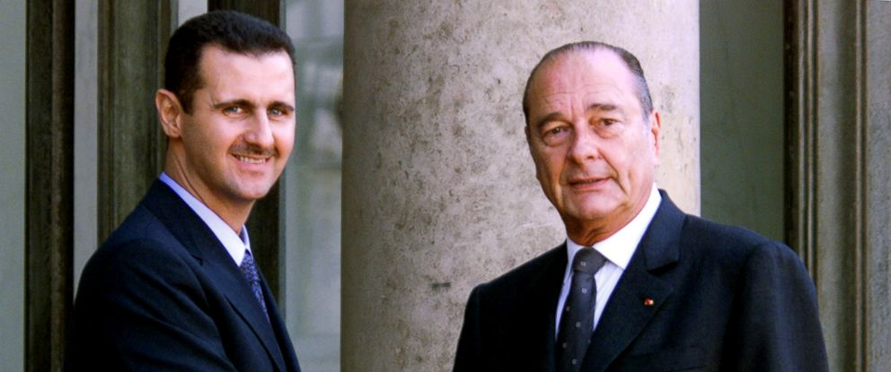 PHOTO: In this file photo taken on June 25, 2001 Syrian President Bashar al-Assad is greeted by French President Jacques Chirac before their meeting at the Elysee Palace in Paris.