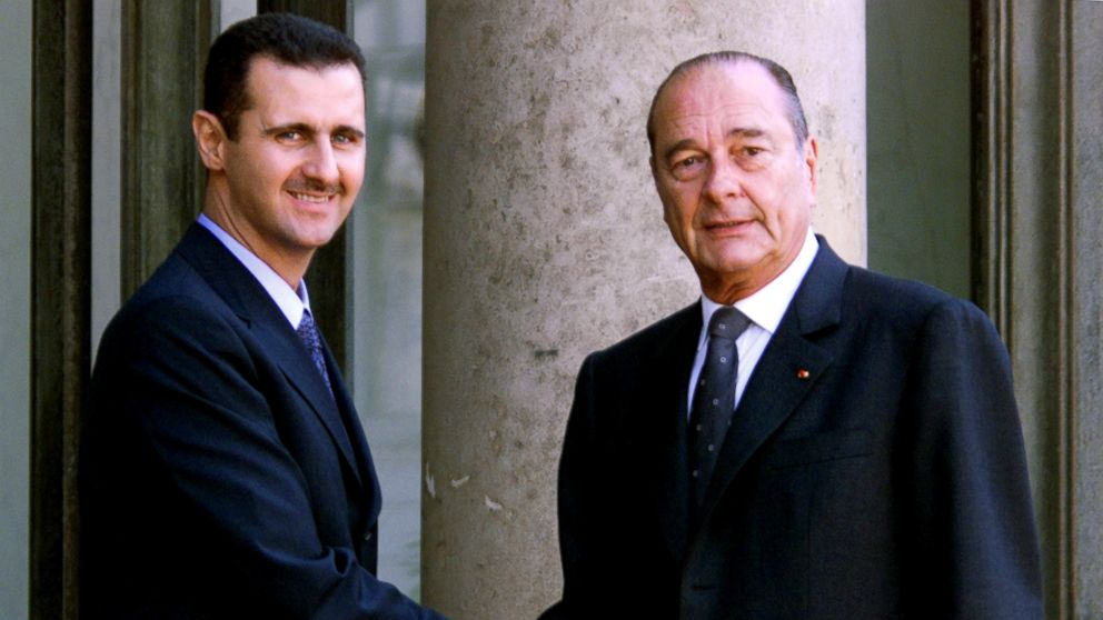 In this file photo taken on June 25, 2001 Syrian President Bashar al-Assad is greeted by French President Jacques Chirac before their meeting at the Elysee Palace in Paris.