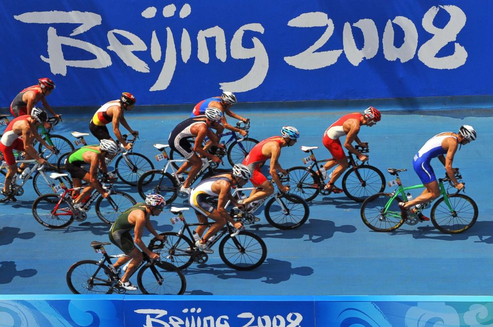 PHOTO: The pack cycle past a Beijing 2008 Olympic logo in the mens triathlon competition at the Beijing 2008 Olympic Games, Aug. 19, 2008.