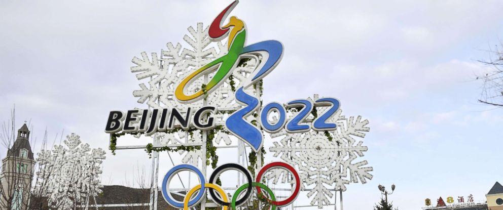 PHOTO: A man walks by a billboard promoting the Beijing Winter Olympics in 2022 in Zhangjiakou, China, Dec. 19, 2017.