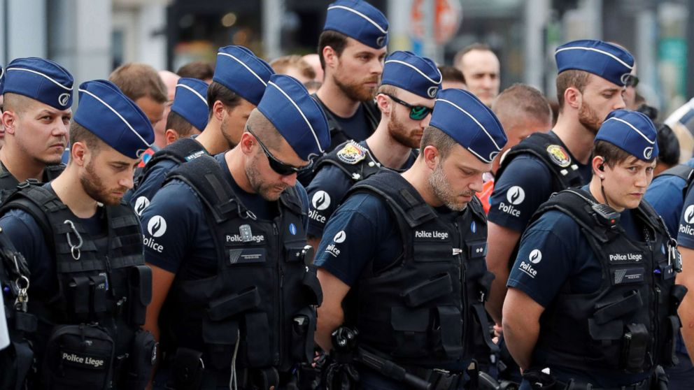 Policemen gather as they prepare to observe a minute of silence in Liege, Belgium May 30, 2018.