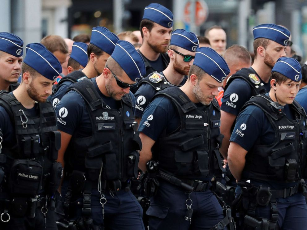 PHOTO: Policemen gather as they prepare to observe a minute of silence in Liege, Belgium May 30, 2018.