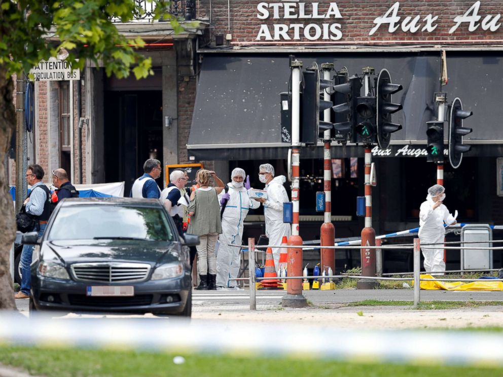 PHOTO: Police officers and forensics experts are seen on the scene of a shooting in Liege, Belgium, May 29, 2018.