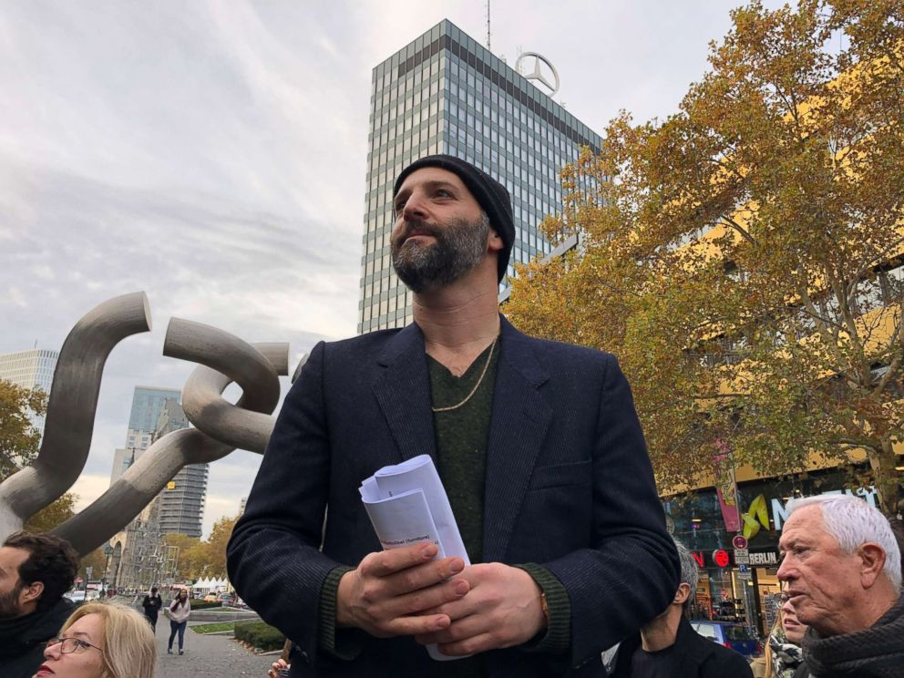 PHOTO: Israeli tour guide Ben Fisher leads a historical tour commemorating Kristallnacht in Berlin.