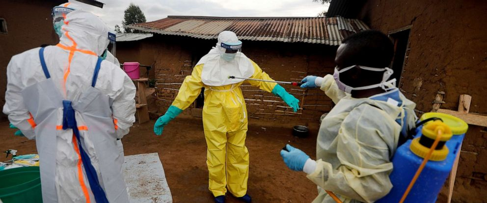 PHOTO: Kavota Mugisha Robert, a healthcare worker, vdecontaminates his colleague after he entered the house of 85-year-old woman, suspected of dying of Ebola, in the eastern Congolese town of Beni in the Democratic Republic of Congo, Oct. 8, 2019.
