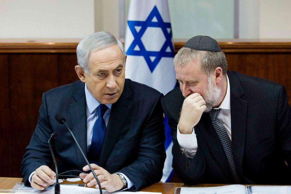 In this Nov. 8, 2015 file photo, Israel's Prime Minister Benjamin Netanyahu, left, speaks with then Cabinet Secretary Avichai Mandelblit during the weekly cabinet meeting in Jerusalem.