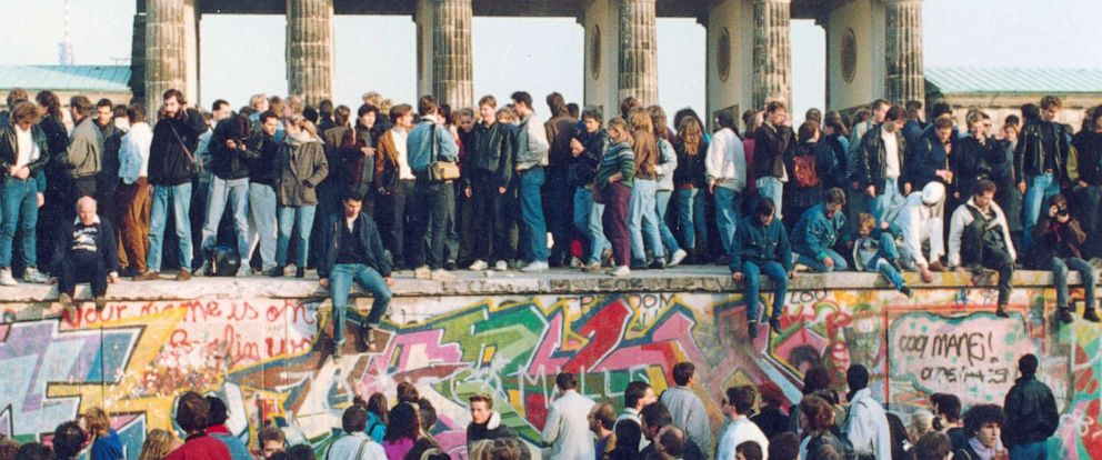 PHOTO: In this Nov. 10, 1989, file photo, Germans from East and West stand on the Berlin Wall in front of the Brandenburg Gate in Berlin.