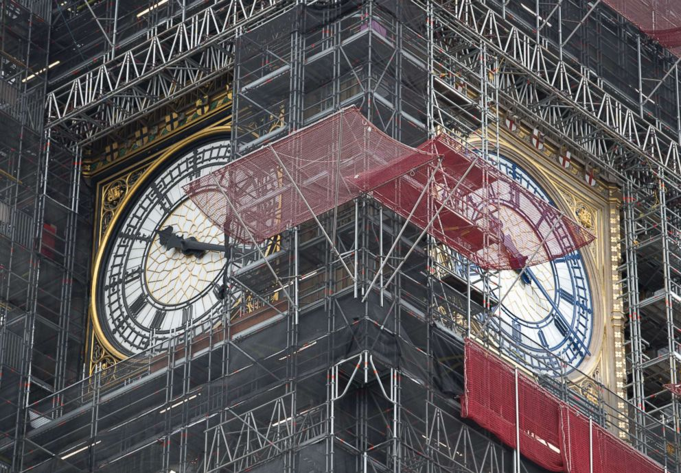 PHOTO: A part of the clock tower has been revealed for the first time since restoration work began in 2017. And it shows a mostly blue face (replacing black).