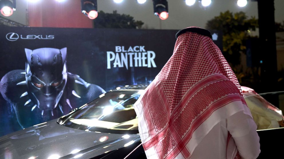 "A Saudi man looks at a car during a cinema test screening in Riyadh, Saudi Arabia, April 18, 2018. Blockbuster action flick ""Black Panther"" play at a cinema test screening in Saudi Arabia on April 18, the first in a series of trial runs before movie theaters open to the wider public next month."