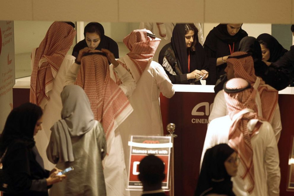 Saudi moviegoers buy tickets at the box office during the opening of the AMC Entertainment cinema theatre at the King Abdullah Financial District in Riyadh, Saudi Arabia, April 18, 2018.
