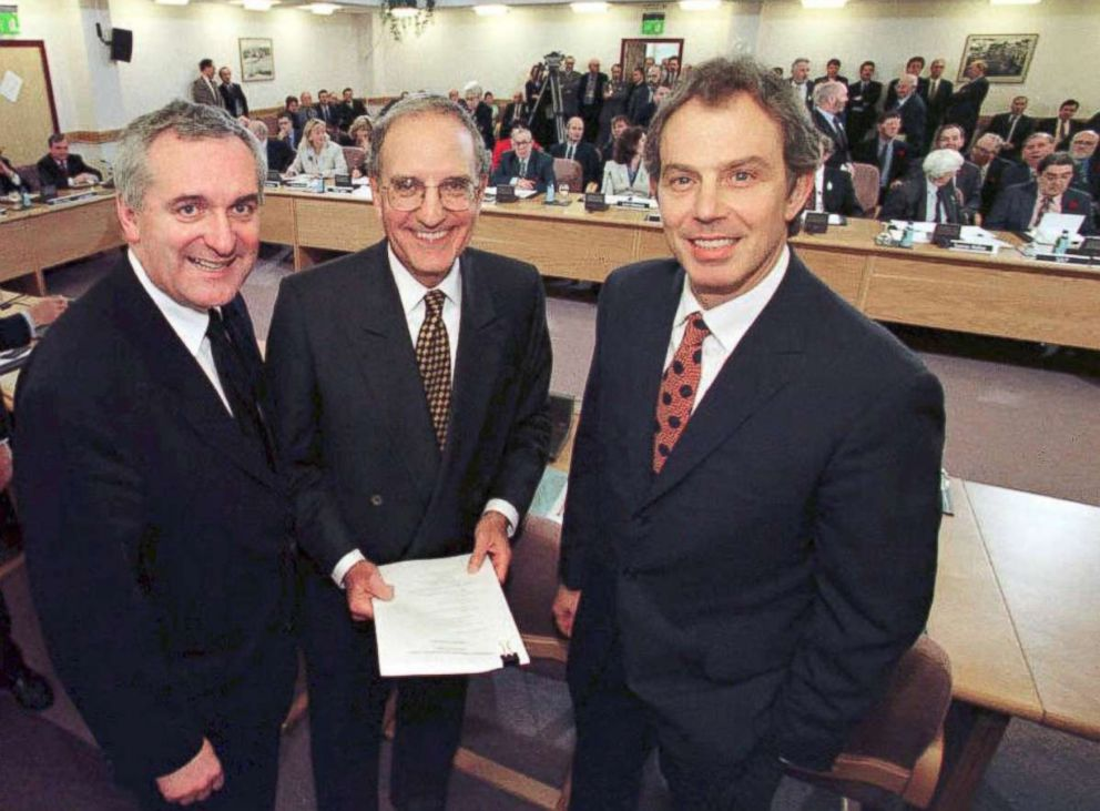 PHOTO: British Prime Minister Tony Blair (R), Sen. George Mitchell (C) and Irish Prime Minister Bertie Ahern (L) smile after signing an historic agreement for peace in Northern Ireland, ending a 30-year conflict, April 10, 1998.
