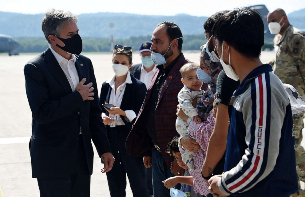 PHOTO: Secretary of State Antony Blinken meets with an Afghan refugee family outside Hangar 5 for evacuation operations at Ramstein Air Base in Germany on Sept. 8, 2021.