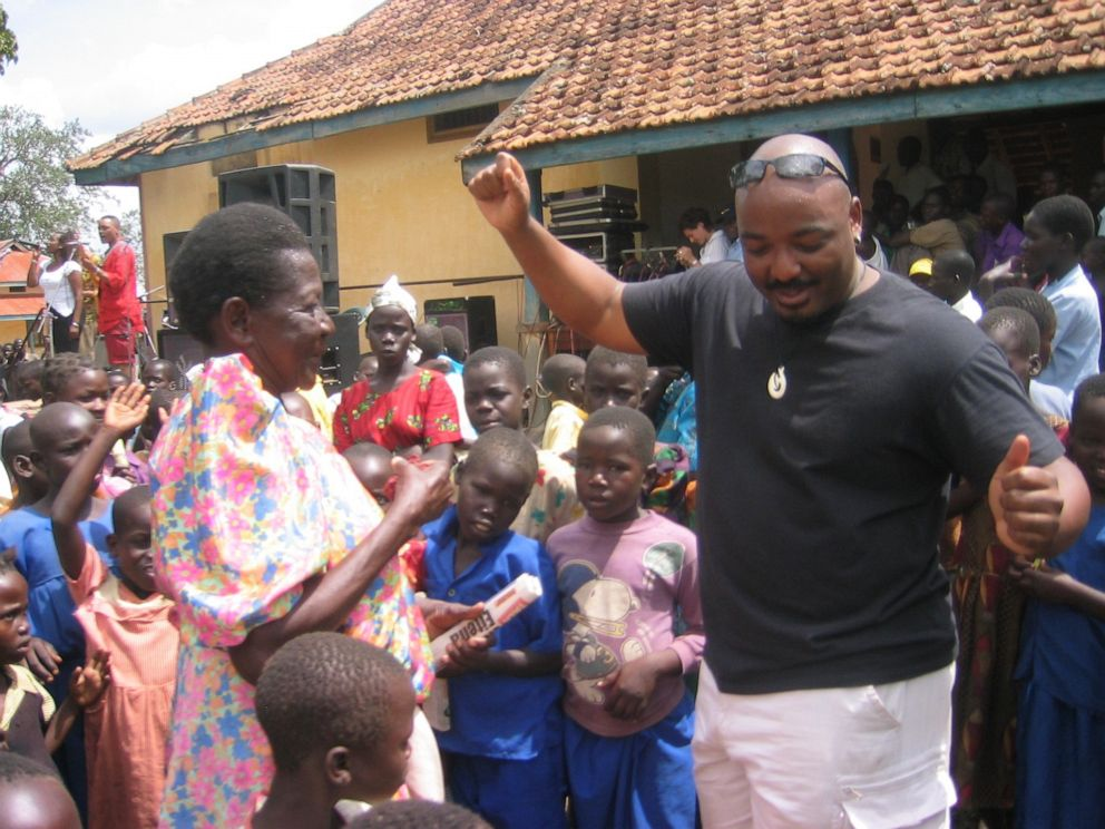PHOTO: Darrell Blocker dancing during a 2004 visit to Soroti, Uganda, with his band, the Kampala Jazz All-Stars.