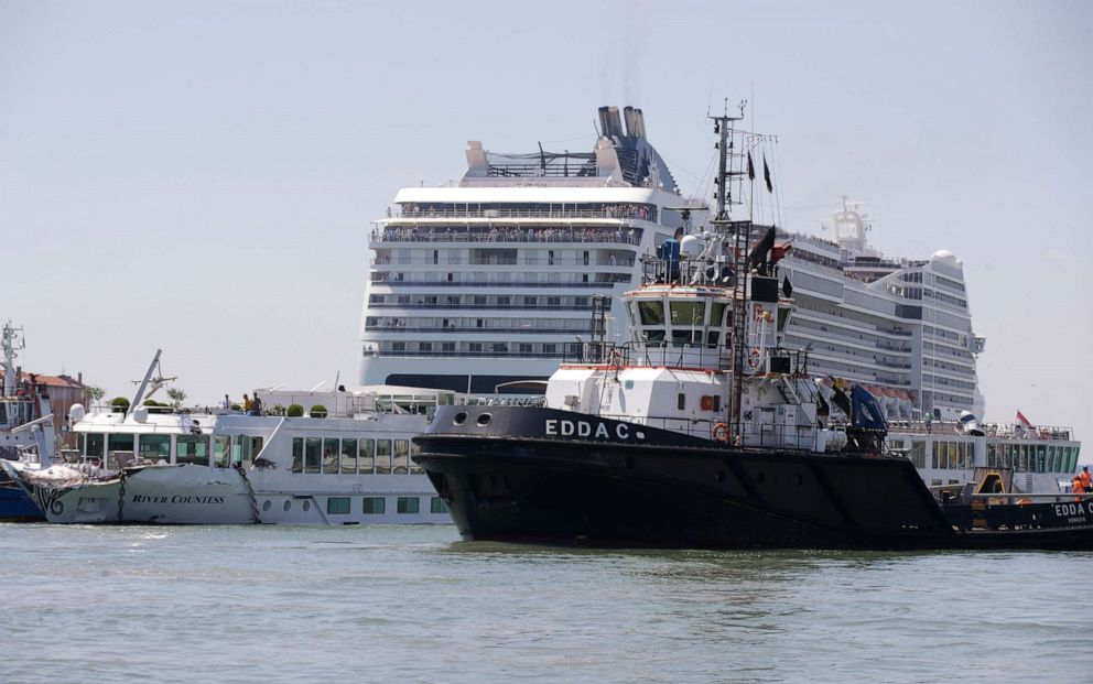 PHOTO:A tourist river boat, left, is dwarfed by the MSC Magnifica cruise ship passing by, in Venice, Italy, June 2, 2019.