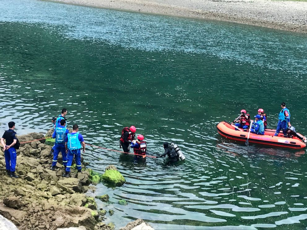 PHOTO: In this photo released by Chinas Xinhua News Agency, rescuers search a river after a boat capsized near Banrao village in southwestern Chinas Guizhou province, Friday, May 24, 2019.