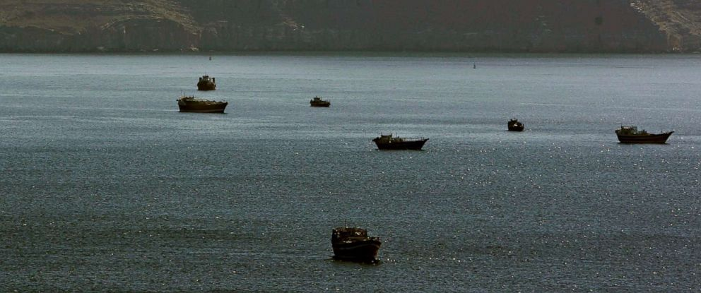 PHOTO: Trading dhows and ships are docked on the Persian Gulf waters near the town of Khasab, in Oman, Jan. 19, 2012.