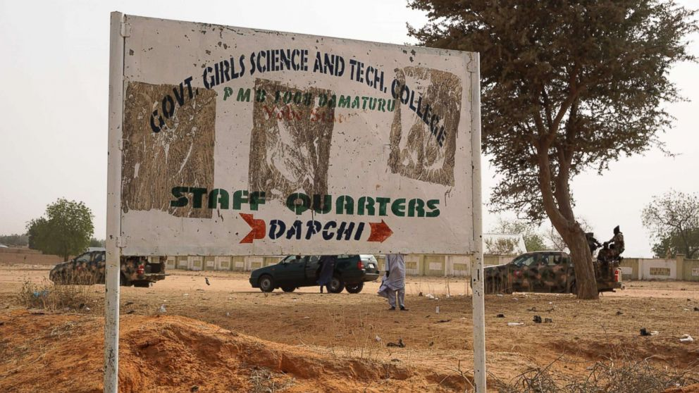 PHOTO: Soldiers (R) drive past a signpost leading to the Government Girls Science and Technical College staff quarters in Dapchi, Nigeria, Feb. 22, 2018.