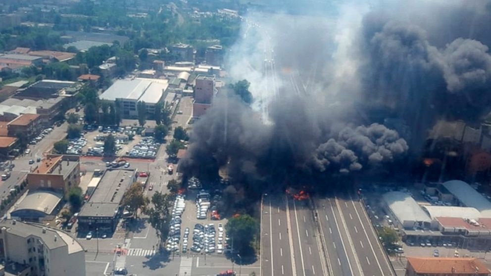 An aerial image provided by Italian firefighters shows smoke and flame after an explosion on a highway in the outskirts of Bologna, Italy, Aug. 6, 2018.