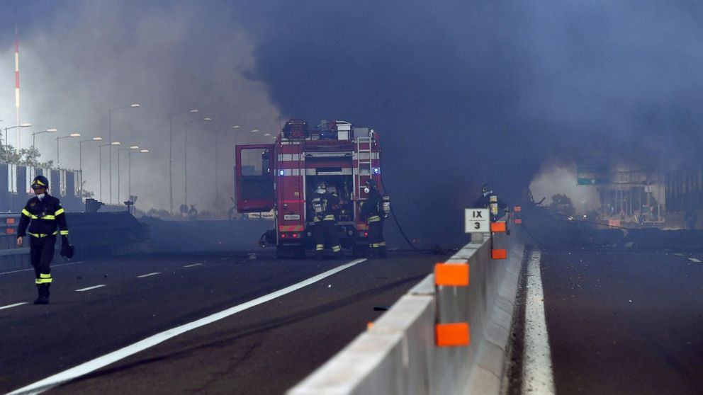 Firefighters work at the scene where a tanker truck exploded on a motorway just outside Bologna, northern Italy, on Aug. 6, 2018.