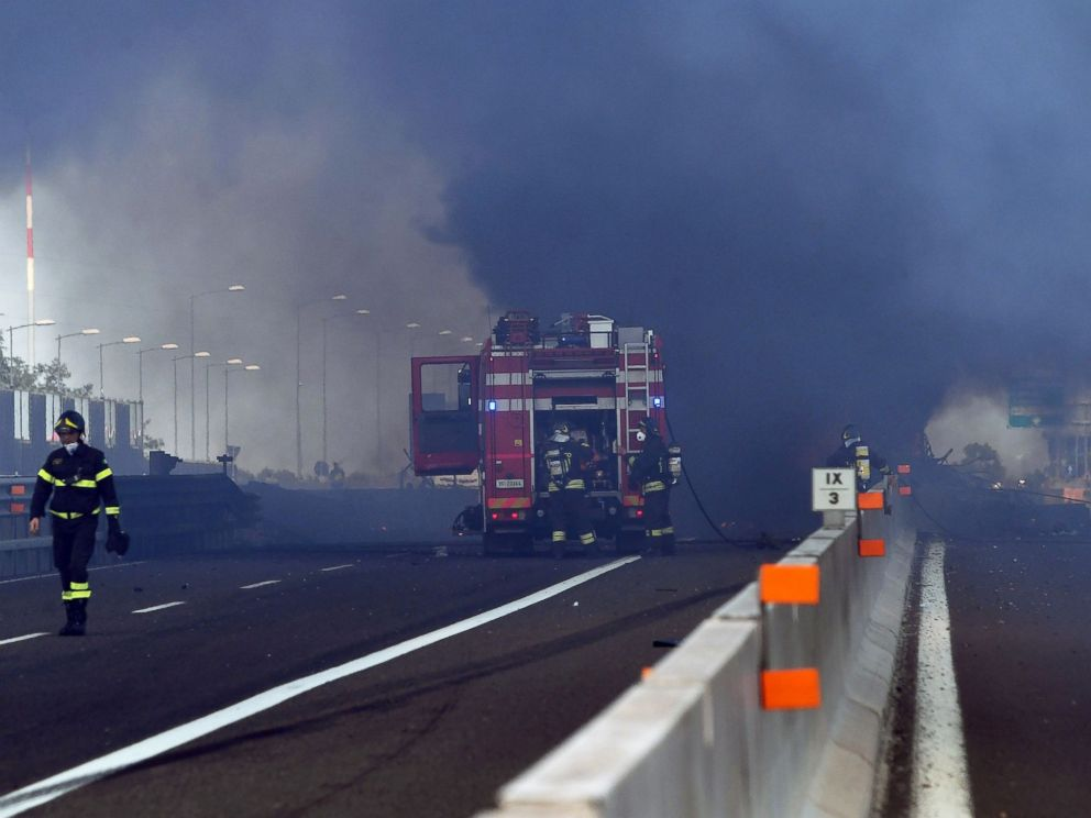 PHOTO: Firefighters work at the scene where a tanker truck exploded on a motorway just outside Bologna, northern Italy, on Aug. 6, 2018.