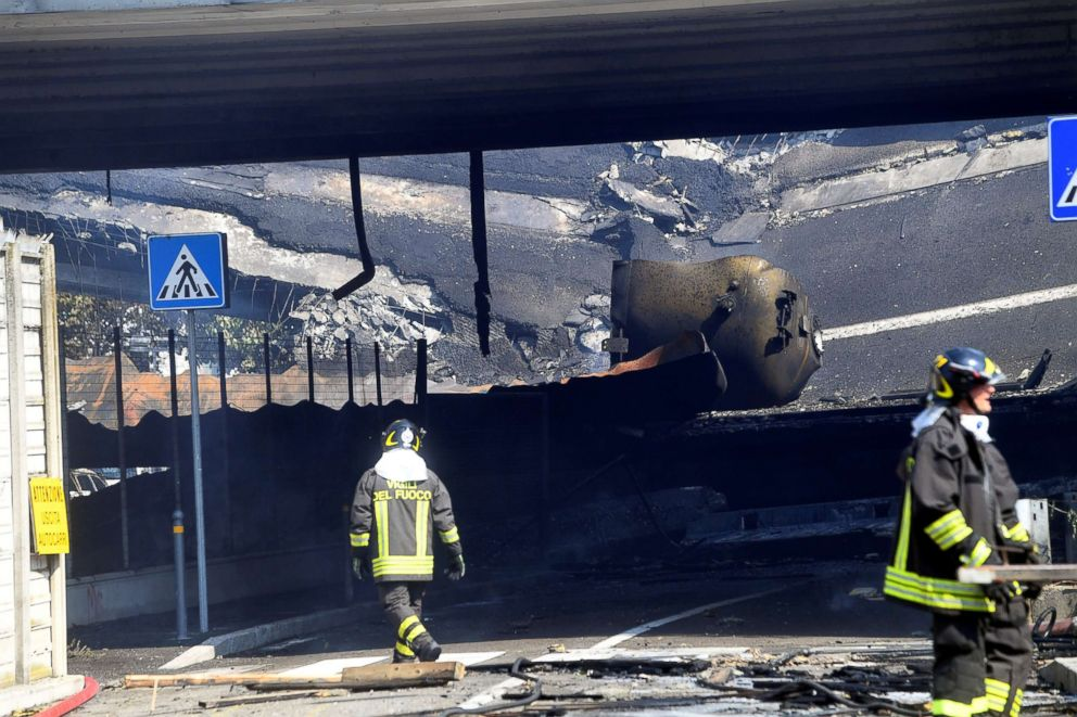 PHOTO: Firefighters work near the motorway after an accident caused a large explosion and fire on the outskirts of Bologna, Italy, Aug. 6, 2018.