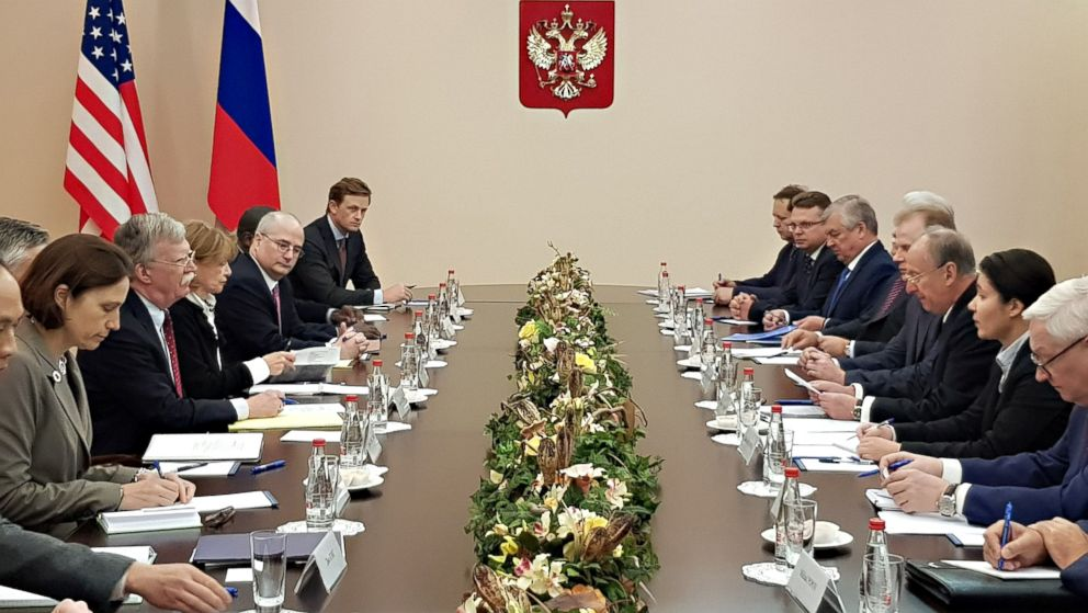 A handout photo made available by the Russian Security Council press service shows Russian Security Council Secretary Nikolai Patrushev, third from right, speaking with US National Security Adviser John Bolton, fourth from left, during their meeting in Moscow, Oct. 2018. Bolton is on a two-day to Russia, after US President Donald Trump announced his county was unilaterally pulling out of the Intermediate-Range Nuclear Forces (INF) Treaty.