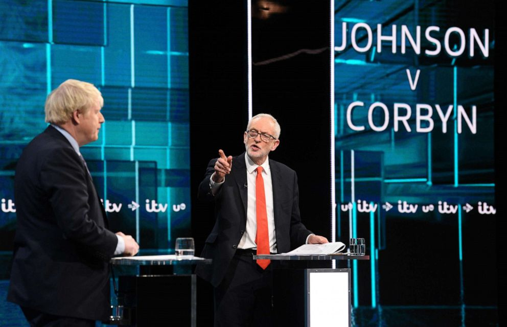 PHOTO: A handout picture taken and released by ITV on Nov. 19, 2019, shows Jeremy Corbyn and Prime Minister Boris Johnson as they debate on the set of Johnson v Corbyn: The ITV Debate in Salford, north-west England.