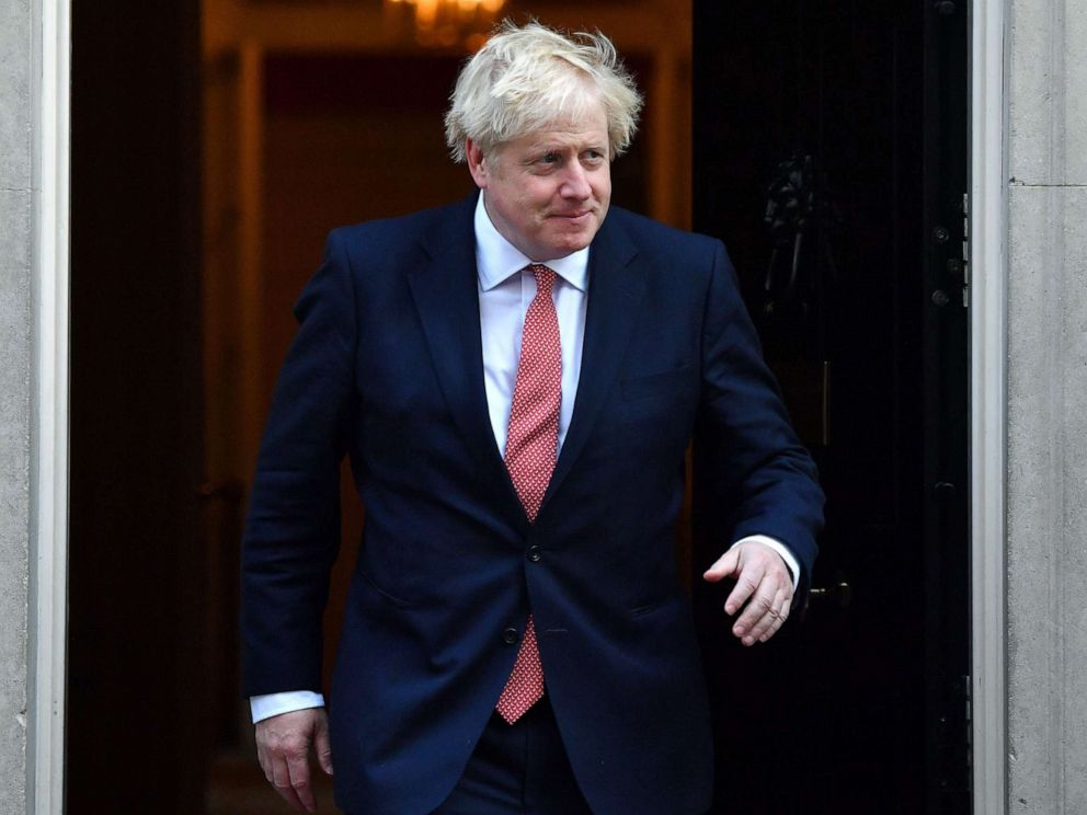 PHOTO: Britains Prime Minister Boris Johnson walks out of 10 Downing street in central London on Sept. 20, 2019.