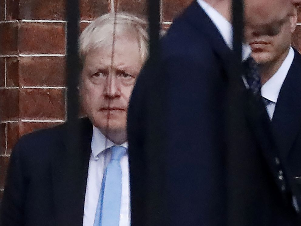 PHOTO: Britains Prime Minister Boris Johnson (L) leaves from the rear of 10 Downing Street in central London on October 16, 2019.