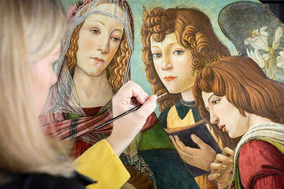 PHOTO: English Heritage Conservator Rachel Turnbull completes the conservation of Madonna of the Pomegranate, a painting revealed as a rare example by the workshop of Botticelli, pictured made available March 28, 2019.