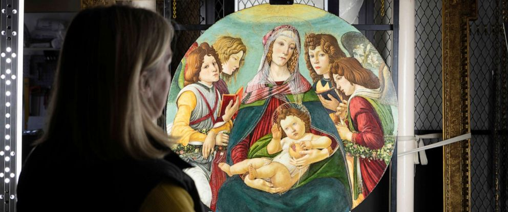 "PHOTO: English Heritage Conservator Rachel Turnbull completes the conservation of ""Madonna of the Pomegranate"", a painting revealed as a rare example by the workshop of Botticelli, pictured made available March 28, 2019."