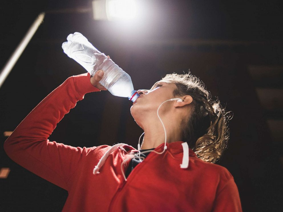 PHOTO: In this undated file photo, a woman drinks bottle water after a workout.