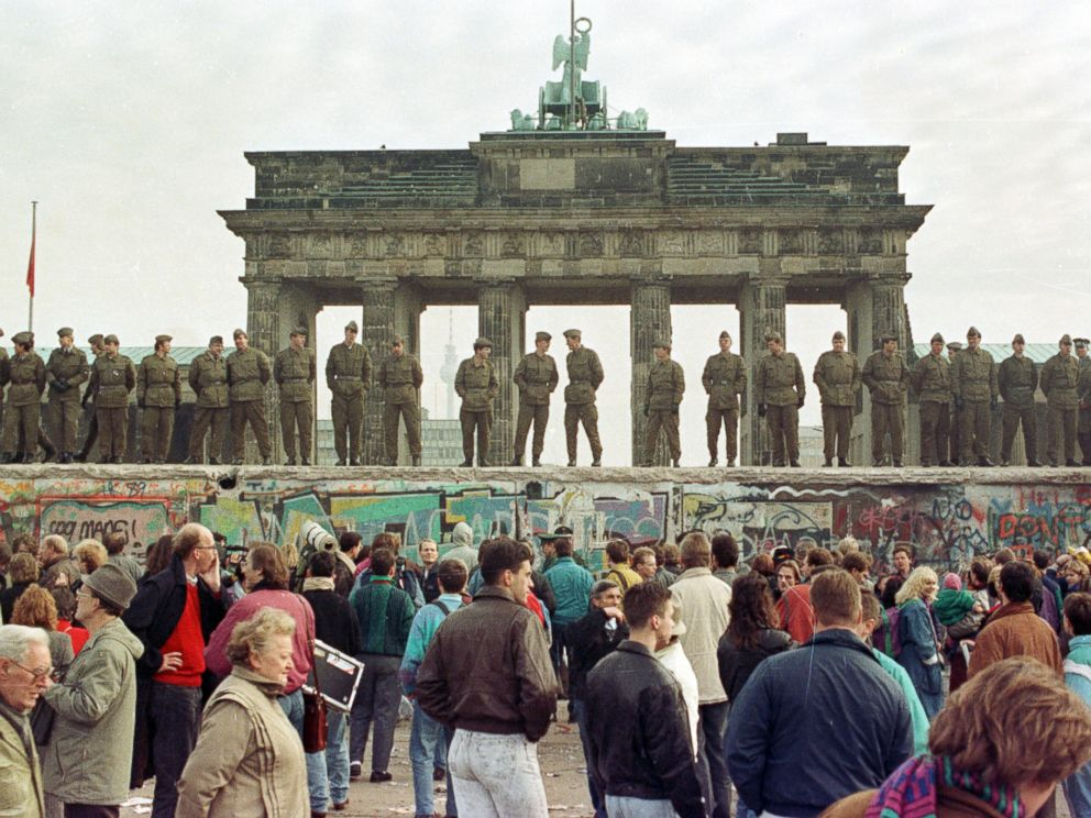 PHOTO: In this file photo, East Berlin border guards stand atop the Berlin Wall in front of the Brandenburg Gate, Nov. 11, 1989.
