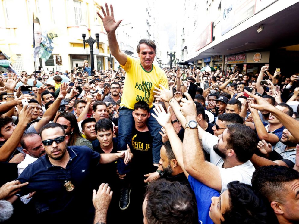 PHOTO: Presidential candidate Jair Bolsonaro is taken on the shoulders of a supporter moments before being stabbed during a campaign rally in Juiz de Fora, Brazil, Sept. 6, 2018.