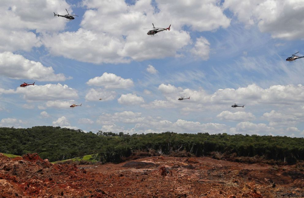 Helicopters hover over an iron ore mining complex to release thousands of flower petals paying homage to the 110 victims confirmed killed and 238 who are still missing after a mining dam collapsed there a week ago, in Brumadinho, Brazil, Feb. 1, 2019.