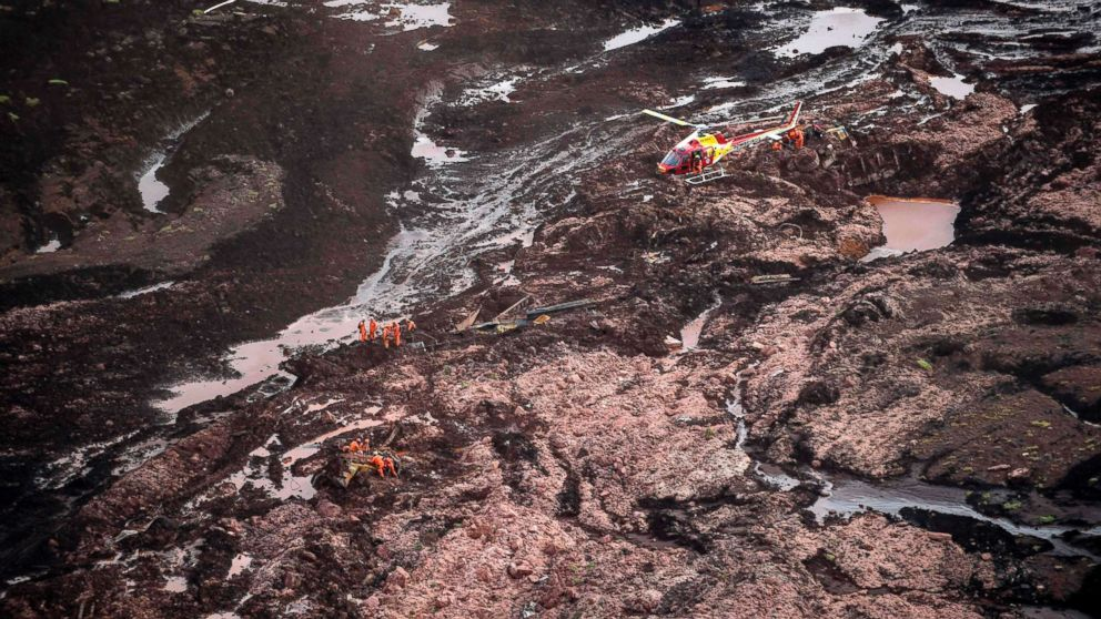 Rescuers search for victims after the collapse of a dam, which belonged to Brazil's giant mining company Vale, near the town of Brumadinho in southeastern Brazil, Jan. 25, 2019.