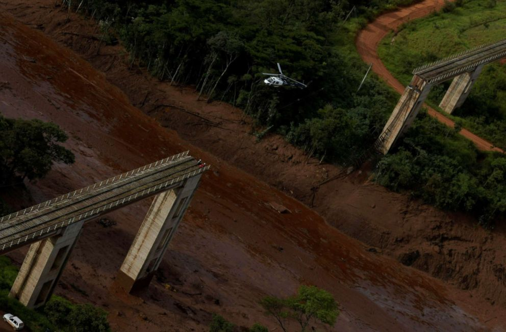 PHOTO: A helicopter flies over an area where a dam owned by Brazilian miner Vale SA burst, in Brumadinho, Brazil, Jan. 25, 2019.