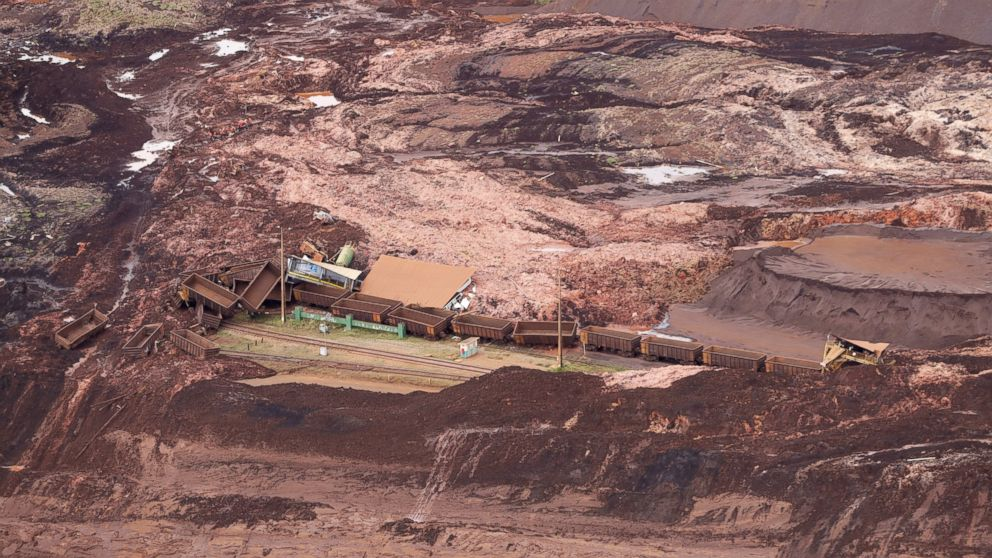 An aerial view shows destroyed vehicles and wagons after a dam collapsed in Brumadinho, Brazil, Saturday, Jan. 26, 2019.