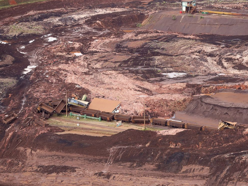 PHOTO: An aerial view shows destroyed vehicles and wagons after a dam collapsed in Brumadinho, Brazil, Saturday, Jan. 26, 2019.