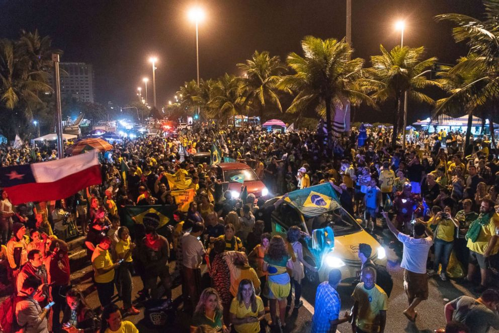 PHOTO: Supporters of Jair Bolsonaro, presidential candidate with the Social Liberal Party celebrate in front of his house in Rio de Janeiro, Oct. 7, 2018.