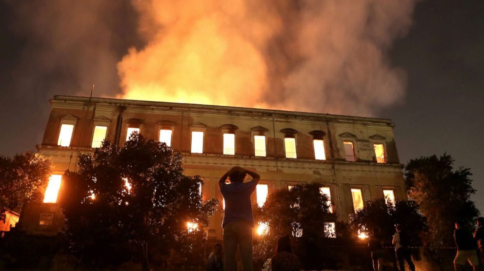 PHOTO: People watch as a fire burns at the National Museum of Brazil in Rio de Janeiro, Sept. 2, 2018.