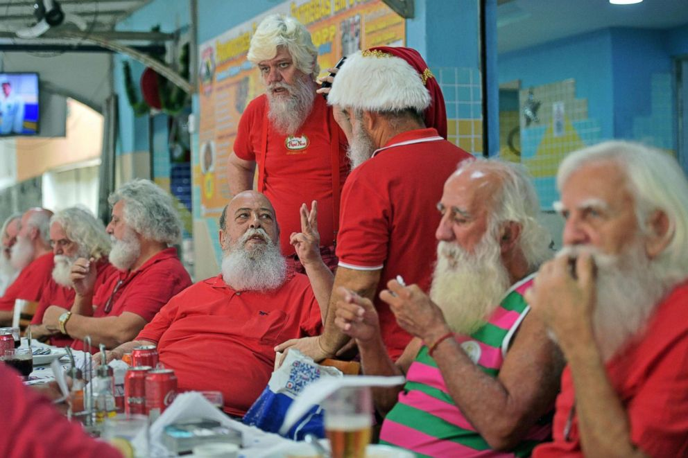 Members of Brazil's Santa Claus school gather at a restaurant for an annual event to mark the end of the season, in Rio de Janeiro, Dec. 26, 2018.