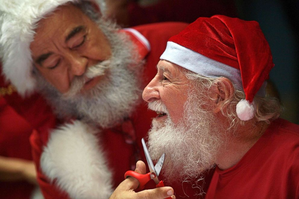 "Saymon Claus, a student of Brazil's Santa Claus school, has his beard trimmed to mark the end of the season during an annual event called ""Barbas de Molho"" at a restaurant in Rio de Janeiro, Dec. 26, 2018."