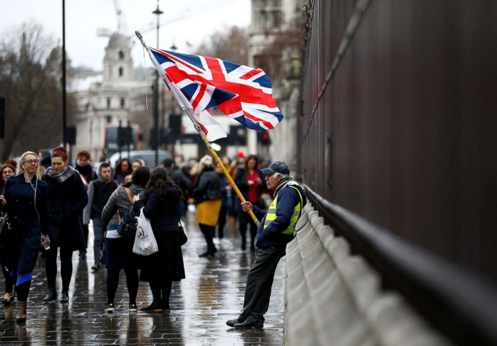 PHOTO: People walk past a pro-Brexit protester outside the Houses of Parliament, after Prime Minister Theresa Mays Brexit deal was rejected in London, Jan. 16, 2019.