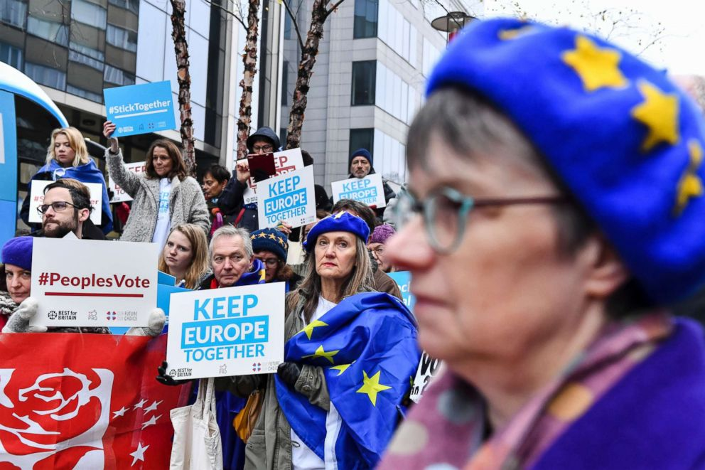 PHOTO: Demonstrators hold signs as they protest outside an EU summit in Brussels, , Nov. 25, 2018. European Union leaders are gathering to seal an agreement on Britains departure from the bloc next year.