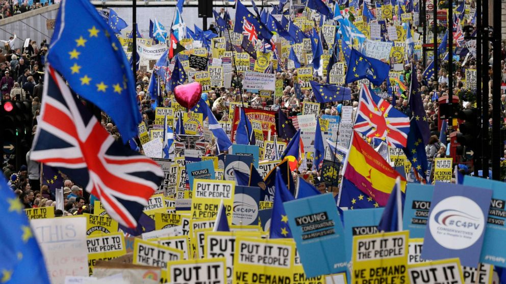 Demonstrators carry posters and flags during a Peoples Vote anti-Brexit march in London, March 23, 2019. The march, organized by the People's Vote campaign is calling for a final vote on any proposed Brexit deal.